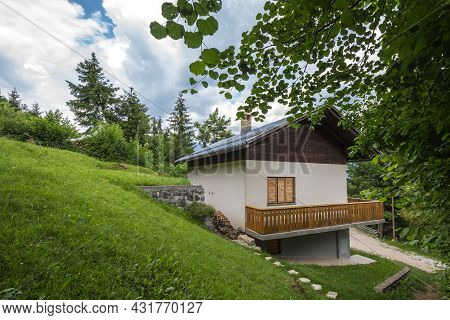 Residential House, A Slovenian Chalet Building, In The Middle Of A Mountain Glade, A Clearing In The