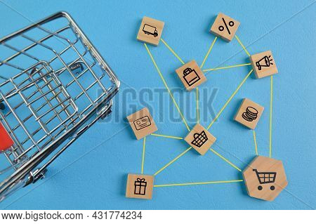 Wooden Block With E-commerce Symbols. Online Shopping, Delivery And Payment Methods Concept