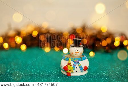 Snowman With Christmas Decoration. Winter, New Year, Xmas Concept. Snowman On Abstract Background. C