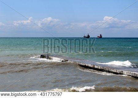 Sea Waves Hit The Breakwater On A Warm Summer Day.