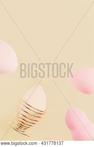 Pink Cosmetic Beauty Blender Sponges On Nude Colored Background. Make Up Sponges Different Shape In
