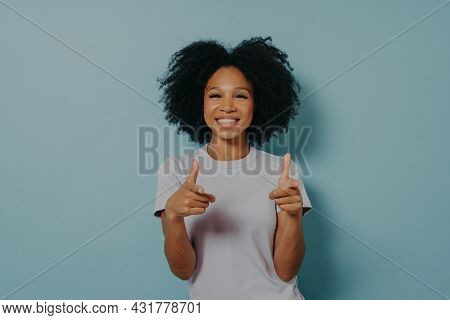 Positive Friendly Dark Skinned Lady Making Finger Gun Gesture And Smiling At Camera, Happy Young Afr