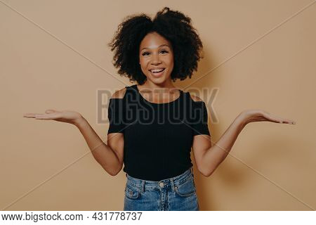 Unsure African Female Model In With Curly Hair Shrugging Shoulders With Uncertainty With Clueless An