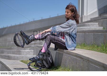 Fit Legs In Kangoo Jumping Shoes. Womanpreparing For Kangoo Jumping Training