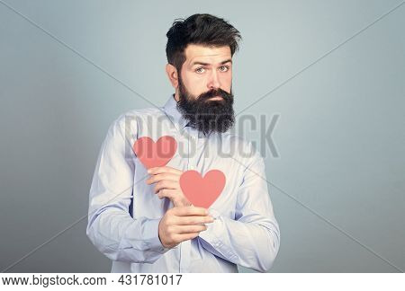 Man Bearded Hipster With Heart Valentine Card. Celebrate Love. Guy Attractive With Beard And Mustach