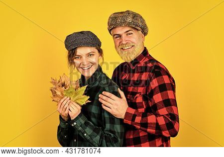 In The Countryside. Falling Leaves, Autumn Floral Elements. Bearded Man And Girl Cap. Retro Couple O