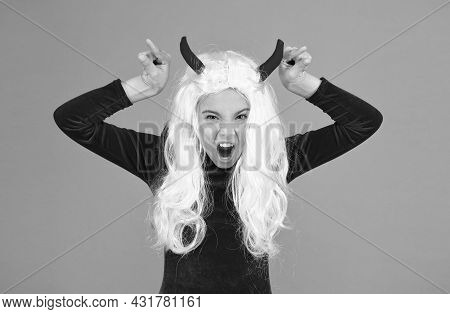 Angry Imp With Red Horns. Devil Costume. Happy Halloween. Creepy Child In Devil Horns. Kid Has White