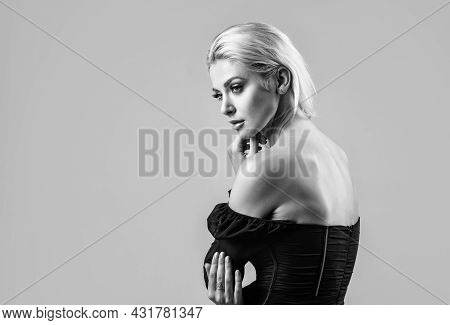 Sexy Lady With Blonde Hair. Female Beauty And Fashion. Attractive Fashion Model. Blond Woman On Grey
