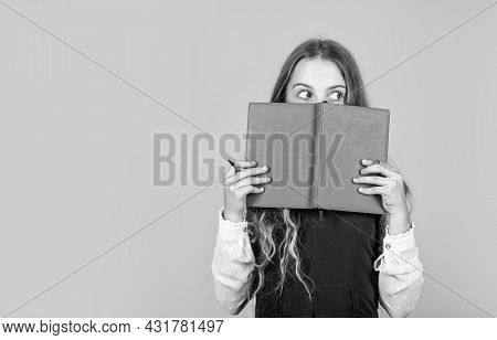 Looking For Relevant Information. Little Girl Cover Face With Book. Information And Education. Schoo