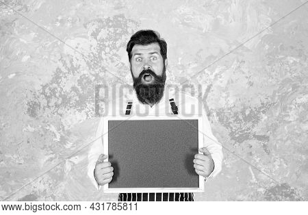 Caucasian Hipster Male Cook With Surprised Face Holding Empty Blackboard Advertising Culinary School