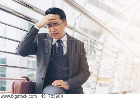 Business Man Wearing A Suit He Sat In The Public Seat Put His Hand On His Head Because Of Stress , R
