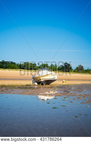 A Motorboat Laying On The Beach Plage De La Loge At Lowtide On A Sunny Summertime On The Isle Of île