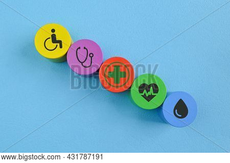 Conceptual Of Healthcare. Wooden Cube Blocks With Healthcare Symbols