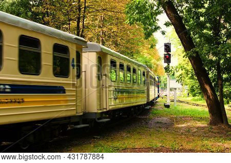 The Children's Train Arrives At The Station. Blurred Motion. Scenic Nature Landscape In Syretsky Par