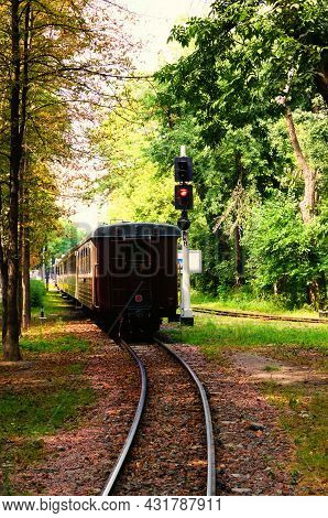 The Children's Train Arrives At The Station. Scenic Sunny Nature Landscape In Syretsky Park. Kyiv Ch