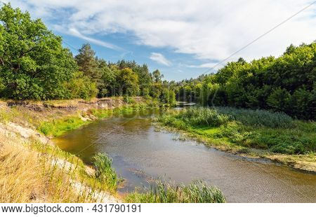 Summer landscape with small river in forest. Take it in Ukraine