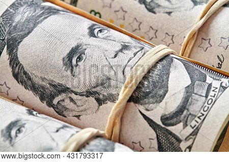 American Twenty Dollar Banknotes Rolled Up As A Tubule. Light Background, Closeup, Selective Focus