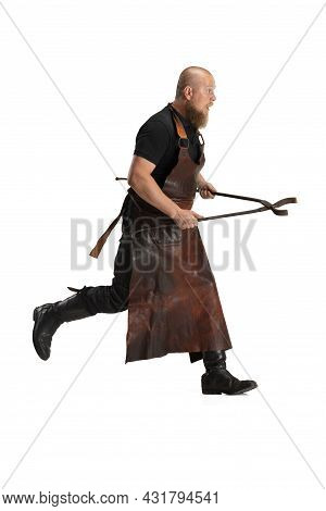 Portrait Of Strong Bearded Bald Man, Blacksmith Wearing Leather Apron Or Uniform Isolated On White S