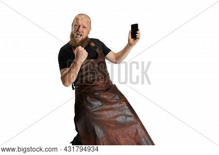 Comic Portrait Of Muscular Bearded Bald Man, Blacksmith In Leather Apron Or Uniform Isolated On Whit