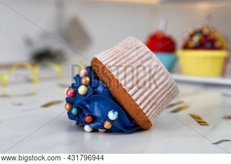 Cupcake Dropped On White Table, Closeup. Troubles Happen