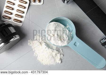 Measuring Scoop Of Amino Acids Powder, Pills And Dumbbells On Light Grey Table, Flat Lay
