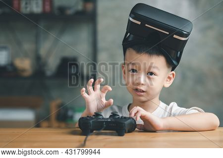 Asian Boy Kid Child Play Virtual Reality Game Wear Vr Glasses And Explore Alternative Reality. Cyber