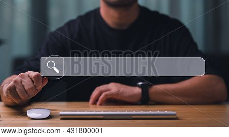 Data Search Technology Search Engine Optimization. Man's Hand Holding Magnifying Glass And Searching