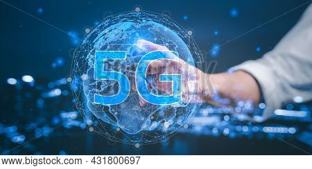 Businessman Pressing On The World Of 5g, Concept Of Future Technology 5g Network Wireless Systems An