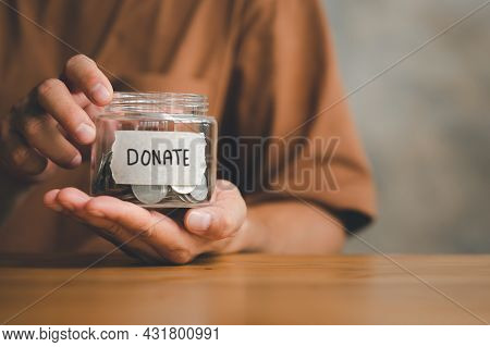 Man Holding Money Jar With Donate Word Written Text Label For Giving And Donation Concept, Saving, F