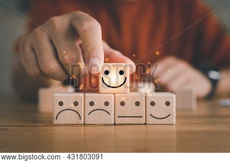 Customer Service Evaluation And Satisfaction Survey Concepts. The Client's Hand Picked The Happy Fac