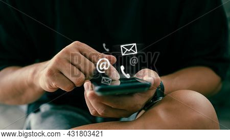 Businessman Holding Mobile Smartphone With Icon Website Page Contact Us Or E-mail Marketing, Contact