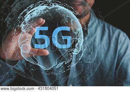 Businessman Holding The World Of 5g, Concept Of Future Technology 5g Network Wireless Systems And In