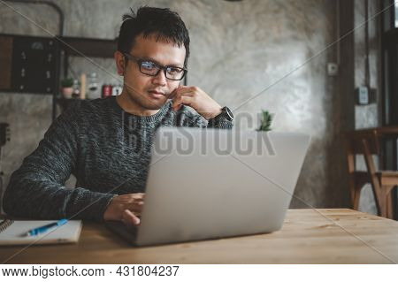 Smart Asian Man Working With Computer Laptop. Concept Work Form Home, Stay At Home. Freelance Life S