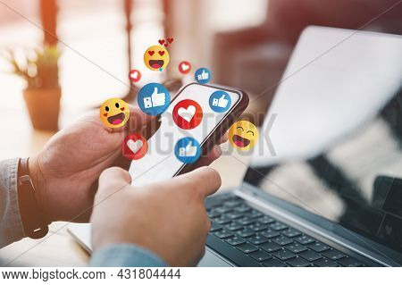 Social Media And Digital Online Concept, Man Using Smart Phone With Social Media. The Concept Of Liv