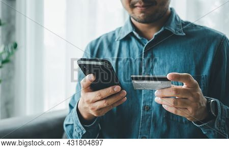 Make Payment With Smartphone And Credit Card, Online Payment Or Internet Banking, Man Makes An Onlin