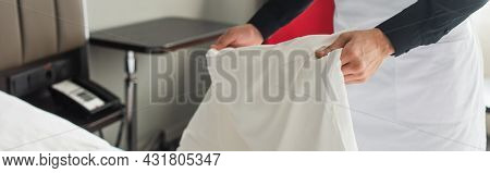 Partial View Of Housekeeper Changing Bedding In Hotel Room, Banner