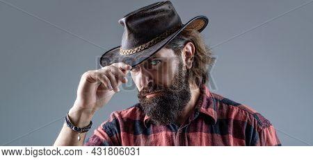 Cowboy Hat. Portrait Of Young Man Wearing Cowboy Hat. Cowboys In Hat. Handsome Bearded Macho. Man Un