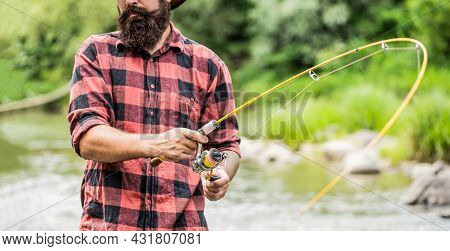 Fishing. Fisherman And Trout. Fly Fishing Time. Fisherman With Fishing Rod On The Lake Shore. Fishin