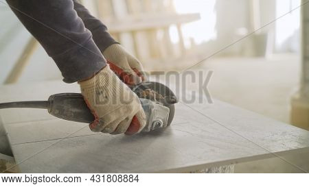 Cutting Ceramic Tiles. Close-up Floor Tiles Are Being Cut With An Electric Cutter By Builders. A Wor