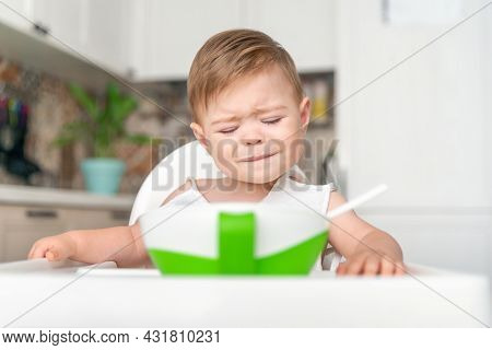Unhappy Little Caucasian Child Boy With Dirty Messy Face Sitting In High Chair. Baby Cry, Capricious