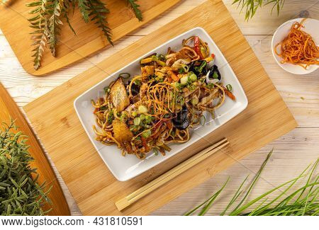 Flat Lay Of Noodles Stir Fry With Ear Wood Mushrooms, Chicken Breast And Vegetables