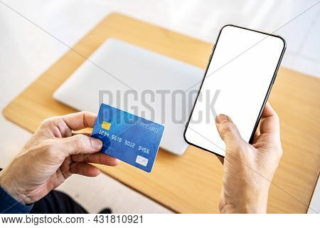 Online Payment. Close Up Man Hands Holding Smartphone With Blank Screen And Credit Card, Making Fina