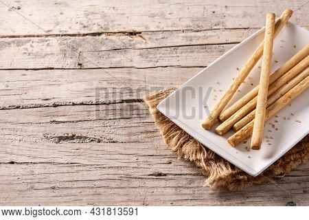 Breadstick Grissini Snack On Wooden Table.copy Space