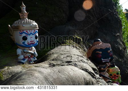 Ravana, Giantess And Hanuman. Standing On The Base Of A Large Tree At The Park. Traveller Doll.
