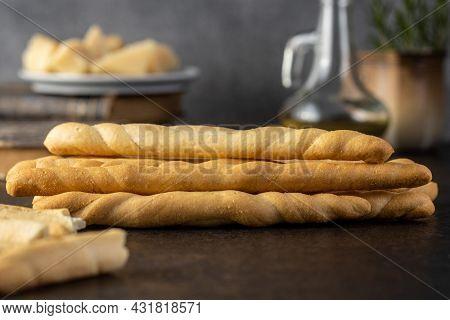 Grissini sticks. Traditional italian bread sticks on black table.