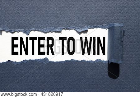 Enter To Win, Text On Torn Paper. Test In Black Letters
