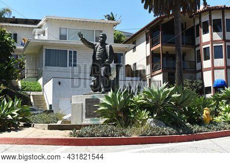SAN PEDRO, CALIFORNIA - 27 AUG 2021: Stephen M. White statue at the entrance to Cabrillo Beach, San Pedro, near the harbor he helped create.