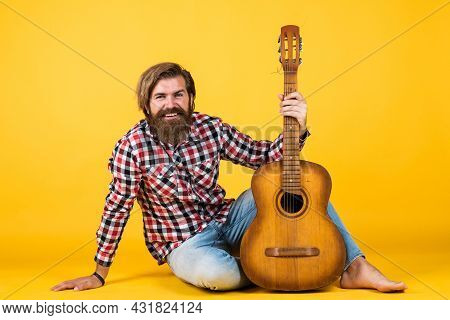 Guitar Player On Yellow Background. Cheerful Guitarist. Charismatic Mature Man Playing Guitar While