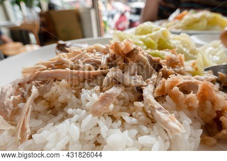 Taiwanese traditional food of shred chicken rice on table