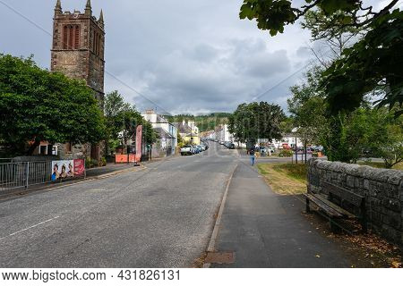 Gatehouse, Scotland - August 15th 2021: The High Street Of Gatehouse Of Fleet And Rutherford Hall, D